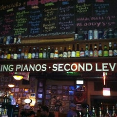 Photo taken at Sluggers World Class Sports Bar and Grill by Tom N. on 8/29/2012