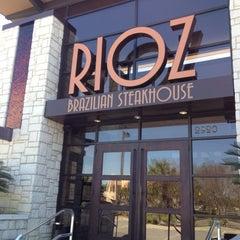 Photo taken at Rioz Brazilian Steakhouse by Kristin W. on 3/6/2012