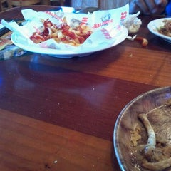Photo taken at Hooters by Tron S. on 11/25/2011