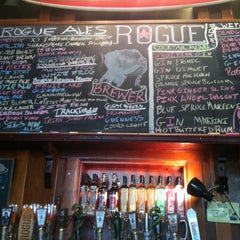Photo taken at Rogue Ales Public House & Distillery by Chris A. on 4/10/2012
