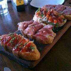 Photo taken at Postino Winecafé by Marissa R. on 4/26/2012