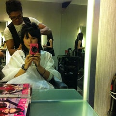 Photo taken at Infinity Hair Salon by Bb T. on 10/14/2011