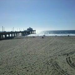 Photo taken at Manhattan Beach by Alan H. on 10/6/2011