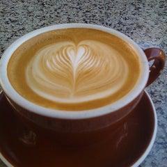 Photo taken at Honolulu Coffee Company by Sunny J. on 1/11/2012