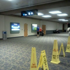 Photo taken at Gate 9 by Darrell G. on 3/26/2012