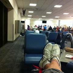 Photo taken at Gate A10 by Jason H. on 7/26/2011