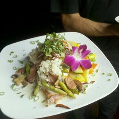 Photo taken at Spy Global Cuisine and Lounge by Caleb J. on 4/2/2011