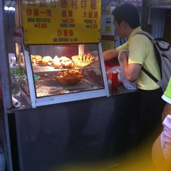 Photo taken at Wai Sek Kai 為食街 by Jackson K. on 7/11/2012