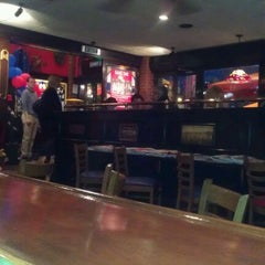 Photo taken at T.G.I. Friday's by Gokhan P. on 4/5/2012