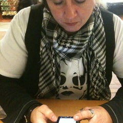 Photo taken at Specialty's Café & Bakery by Rebecca on 11/30/2011