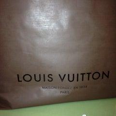 Photo taken at Louis Vuitton by Jennifer C. on 11/27/2011