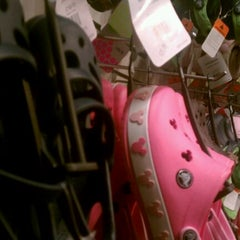 Photo taken at Croc's Store by Sabrina M. on 11/30/2011