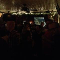 Photo taken at 11th Street Bar by Dan H. on 12/19/2011