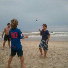 Photo taken at Praia Da Costa by Djanira B. on 12/30/2011