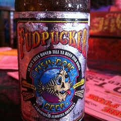 Photo taken at Fudpuckers Beachside Bar & Grill by Beckie R. on 7/6/2011