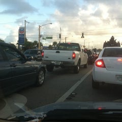 Photo taken at Intersection W Oakland Park Blvd & N Powerline Rd by Roger B. on 9/21/2011