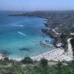 Photo taken at Konnos Beach by Dina C. on 8/27/2012