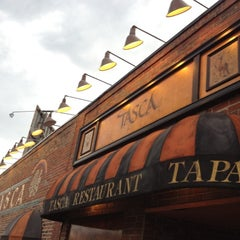 Photo taken at Tasca Spanish Tapas Restaurant & Bar by Mike L. on 6/8/2012