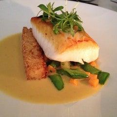 Photo taken at Hawksworth Restaurant by Donna E. on 5/22/2012