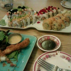 Photo taken at Full Moon Sushi & Bistro by Ricky A. on 11/12/2011