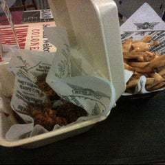 Photo taken at Wingstop by Bryan O. on 1/9/2012