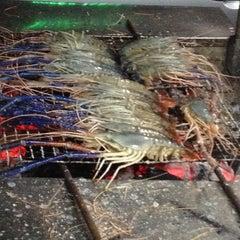 Photo taken at ร้านอีสานพัฒนา (ปากหมา) by Bhirayu O. on 1/20/2012