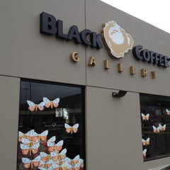 Photo taken at Black Coffee Gallery by Sergio Garval by Carlos R. on 7/27/2012