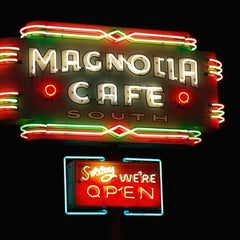 Photo taken at Magnolia Cafe South by Robert R. on 3/12/2012