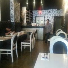 Photo taken at Osha Thai Kitchen by Can Ç. on 8/27/2012