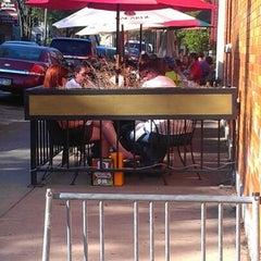 Photo taken at Johnny Mango World Café & Bar by Jeremy D. on 5/19/2012