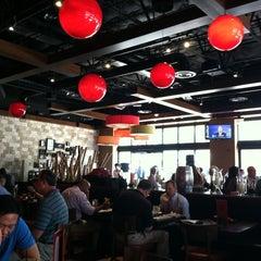 Photo taken at RA Sushi Bar Restaurant by Humphrey C. on 9/29/2011