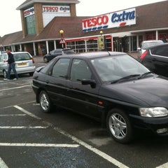 Photo taken at Tesco by Claire B. on 4/15/2011
