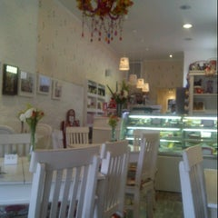 Photo taken at Café des Fleurs by Vanessa R. on 7/25/2012