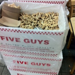 Photo taken at Five Guys by Erica L. on 7/23/2011