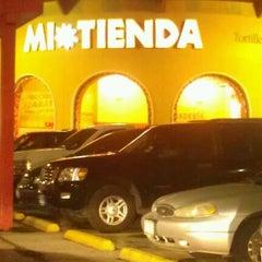Photo taken at Mi Tienda by Stephanie S. on 12/17/2011