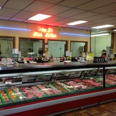 Photo taken at Schmidts Meat Market by Robert D. on 8/3/2012