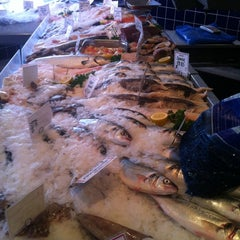 Photo taken at La Poissonnerie Fishmongers by Greg K. on 2/25/2012