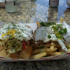 Photo taken at Dogzilla Hot Dogs Truck by Eric S. on 5/30/2012