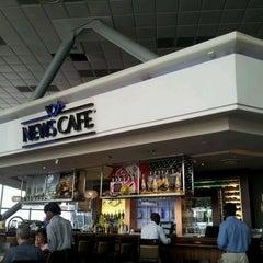 Photo taken at News Cafe by Roger V. on 3/8/2012