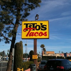 Photo taken at Tito's Tacos by Brian T. on 1/2/2012