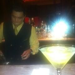 Photo taken at The Library Bar & Cigar Lounge at Four Seasons Hotel Doha by Andrew L. on 12/7/2011