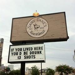 Photo taken at Saint Dane's Bar & Grille by Tina S. on 7/13/2012