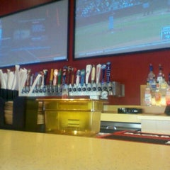 Photo taken at Buffalo Wild Wings by Maggie M. on 3/21/2012