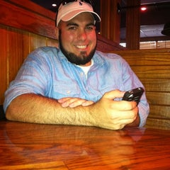 Photo taken at Outback Steakhouse by Amber B. on 7/22/2011