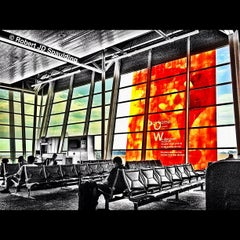 Photo taken at Gate A23 by Robert S. on 7/23/2012