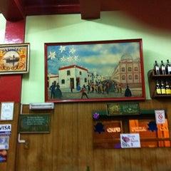 Photo taken at Pizzeria Mi Tio by Marcelo C. on 3/28/2012