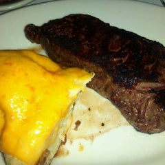 Photo taken at Gibsons Bar & Steakhouse by Andrew D. on 9/9/2011