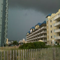Photo taken at 59th St Beach by Natalie F. on 6/25/2012