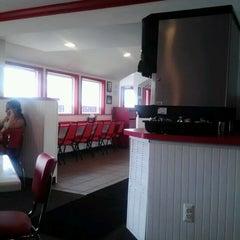 Photo taken at Burger 25 by Julius J. on 8/17/2012