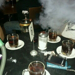 Photo taken at Sugar Night Hookah Lounge by Rachelle on 2/18/2012